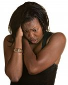 image of low-necked  - Frantic Black woman holding neck and head - JPG