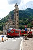 stock photo of engadine  - Swiss mountain train Bernina Express arrive at Italian city Tirano - JPG