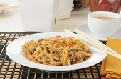 stock photo of lo mein  - a bowl of beef lo mein with take out containers - JPG