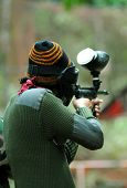 picture of gun shot wound  - Picture of paintball player shooting to the target  - JPG