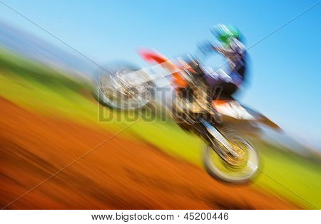 Blurred image of biker on championship, active lifestyle, extreme sport, slow motion, motocross on off-road, speed concept