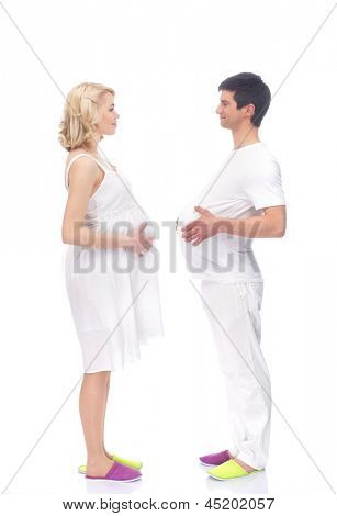 Young attractive couple: pregnant mother and happy father isolated on white