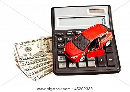 Toy Car, Calculator And Money Over White. Rent, Buy Or Insurance Car Concept