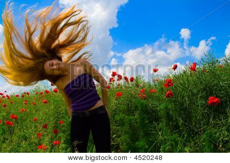 Woman With Moving Hair In Poppy Field