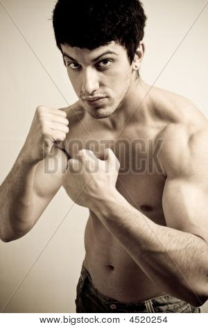 Muscular Male Fighter With Fists Ready To Punch