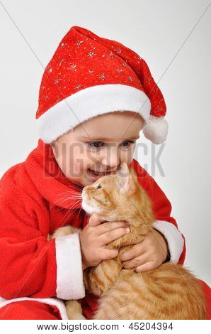 Christmas Toddler Child Plays With A Cat