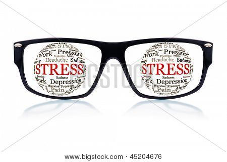 Black eyeglasses with spheres made of words related to stress and depression in place of the eyes