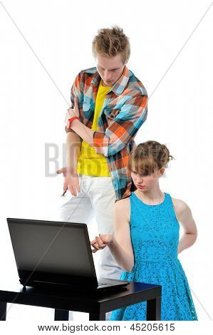 young couple with laptop isolated on white background