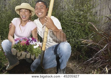 Portrait of happy couple gardening