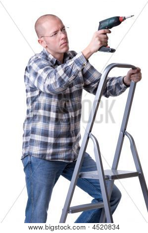 Craftsman On A Ladder With A Cordless Screwdriver