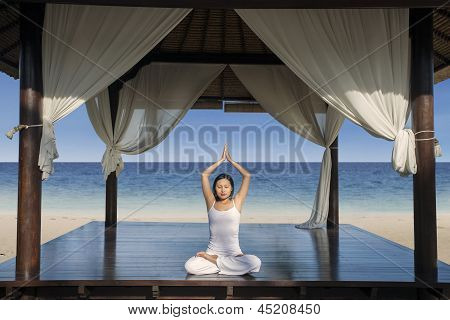 Attractive Woman Practice Yoga At Luxury Beach Resort
