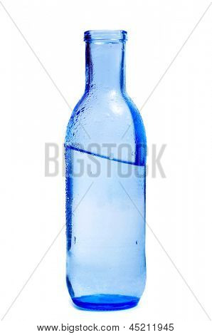 a blue glass bottle of mineral water on a white background