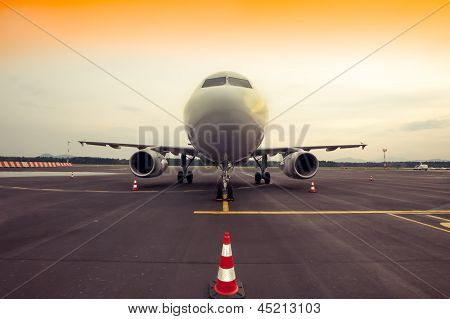 Commercial Airplane Parking At The Airport, With Traffic Cone In Front