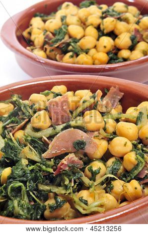closeup of a plate with spanish garbanzos con jamon, chickpeas with serrano ham, served as tapas