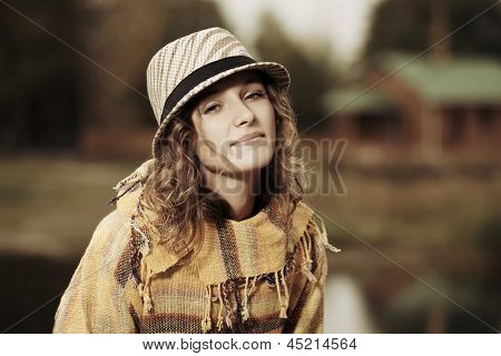 Young hippie woman against a nature background