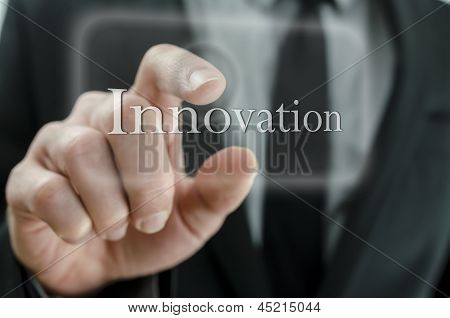 Business Man Pressing Innovation Button On A Touch Screen Interface