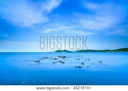 Baratti Bay, Small Rocks In A Blue Ocean On Sunset. Tuscany, Italy.