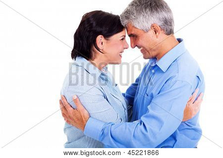 happy middle aged couple hugging each other isolated on white background