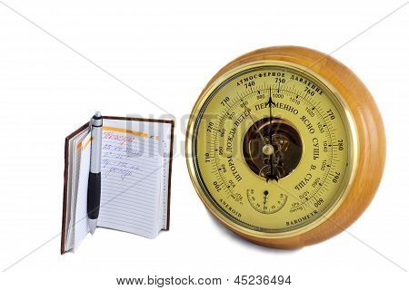 Barometer - Aneroid And The Notebook On A White Background
