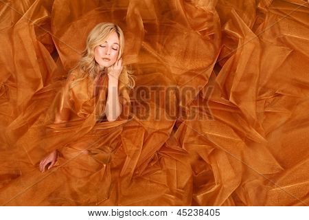 Beautiful Woman Wrapped in Copper Flowing Fabric