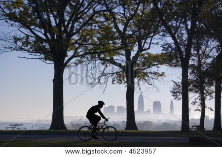 Biker On Foggy Morning