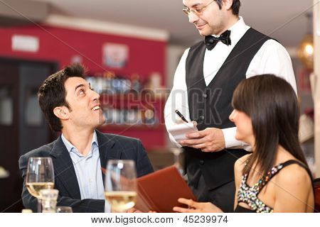 Waiter taking orders in a restaurant