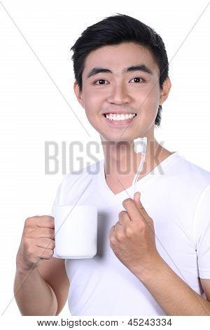 Asian guy brushing teeth and smile