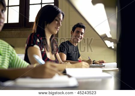 Happy Student Studying And Writing, Portrait Of Hispanic Young Man
