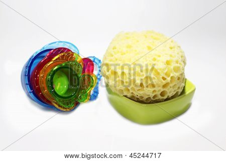 Colored pastic fish with a bath sponge, toys for baby