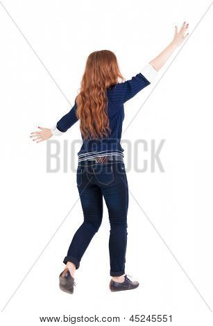 back view walking woman. beautiful redhead girl in motion. backside view person.  Rear view people collection. Isolated over white background. happy girl goes with the placed his hands open to embrace