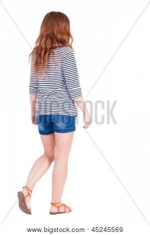 back view of walking young beautiful  redhead woman. girl  watching. Rear view people collection.  backside view of person.  Isolated over white background. girl in denim shorts and striped t-shirt