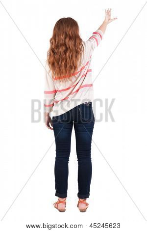 Back view of  pointing woman. beautiful redhaired  girl. Rear view people collection. backside view of person. Isolated over white background. The young red-haired girl holds out her hand to something