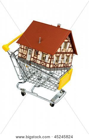 half-timbered house in the shopping cart icon photo for house purchase, financing, costs