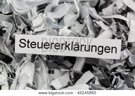 tagged with shredded paper tax returns, symbolic photo for tax burden and storage requirement