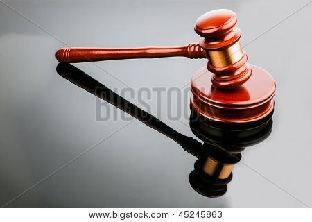 judge or auction hammer symbol photo for authority and decision-making