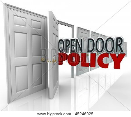 Open Door Policy words in opened doorway to symbolize and illustrate free and welcome communication between management and employees