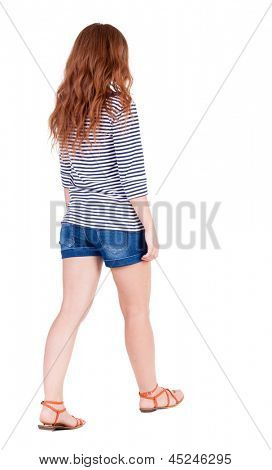 back view of walking young beautiful  redhead woman. girl  watching. Rear view people collection.  backside view of person.  Isolated over white background. young girl slowly comes to a summer