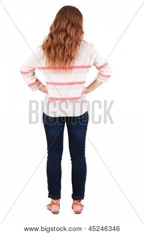 back view standing young beautiful redhead woman. girl  watching. Rear view people collection. backside view person. Isolated over white background. Red-haired girl looking to side with hands on hips