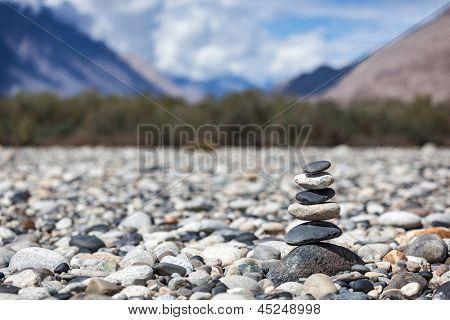 Zen balanced stones stack in Himalayas mountains