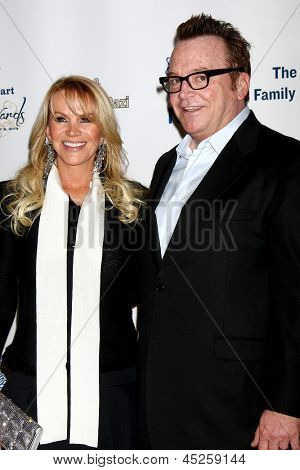 LOS ANGELES - MAY 6:  Joan Dangerfield, Tom Arnold arrives at the 2013 Midnight Mission's