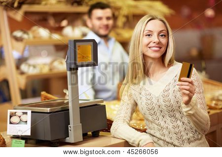 Young girl with a credit card at the store