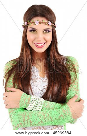 Young beautiful girl with decorative wreath on her head, isolated on white