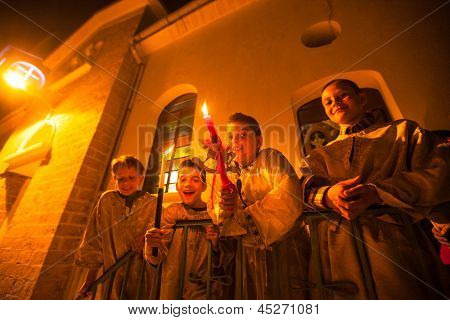 METHANA, GREECE - MAY 5: Unidentified children in the church during the celebration of Orthodox Easter, May 5, 2013 in Methana, Greece.