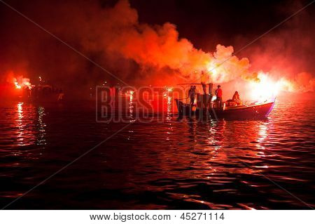 PELOPONNESE, GREECE- MAY 29: The ritual burning of Judas Iscariot at sea during the Orthodox Easter, May 29, 2013 in Peloponnese, Greece.