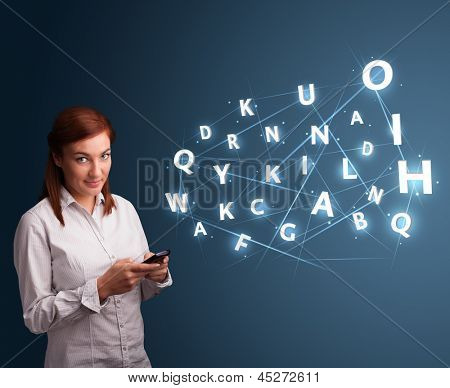 Beautiful young woman typing on smartphone with high tech 3d letters comming out