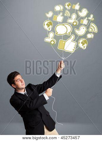 Atraente jovem segurando balão ícone social