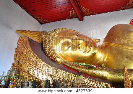 laying Golden Buddha images in Thai Temple