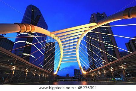 skywalk at bangkok downtown square in business zone at dusk