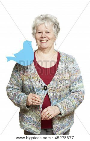Senior Woman Holding A Social Media Sign Smiling