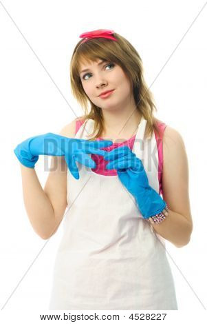 Dreamy Housewife Putting On Rubber Gloves
